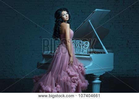Girl And A Big White Piano.