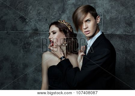 Man Passionately Squeezes The Woman's Face.