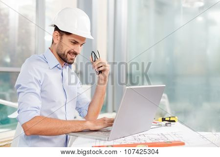 Handsome male engineer is projecting the construction