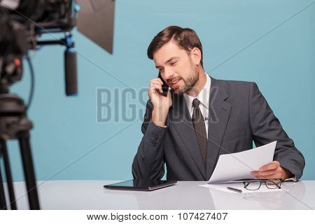 Handsome male reporter is communication on the telephone