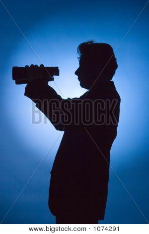 Silhouette Of Man With Binoculars