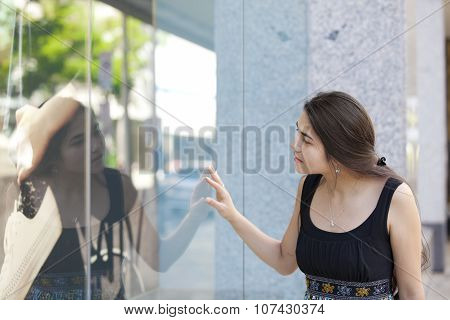 Biracial Teen Girl Window Shopping, Looking Into Store Front Glass