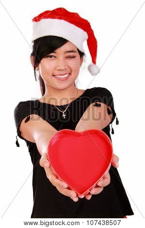 Smiling Xmas Girl Giving Heart
