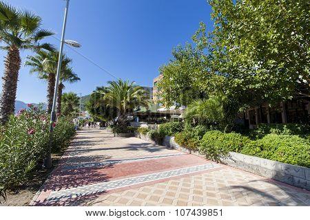 MARMARIS, TURKEY - SEPTEMBER 15, 2014: Unidentified tourists at walkway by the modern hotels in Marmaris Turkey. Marmaris is well-known tourist destination in Turkey.