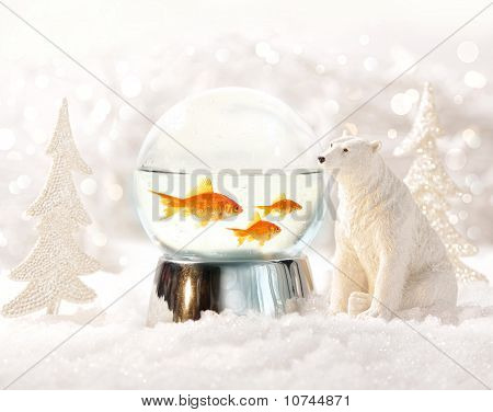 Snow globe with fish in magical winter scene poster