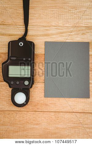 View of a photo flash on wood desk