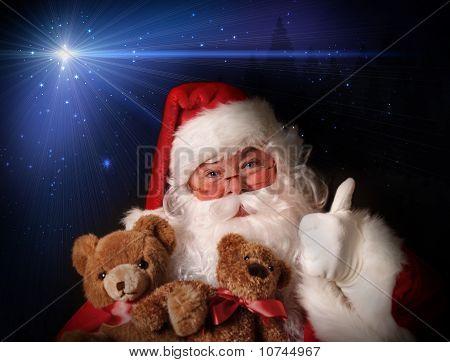Santa Smiling Holding Toy Teddy Bears