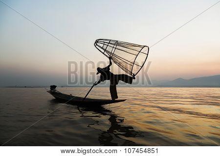 Fishermen In Inle Lakes Sunset, Myanmar. Selective focused.