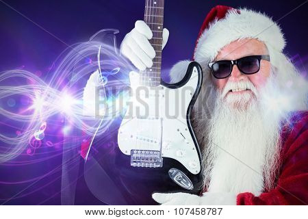 Father Christmas shows a guitar against curved laser light design in purple