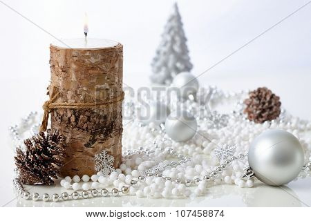Pure natural christmas decoration with ornaments and candle.