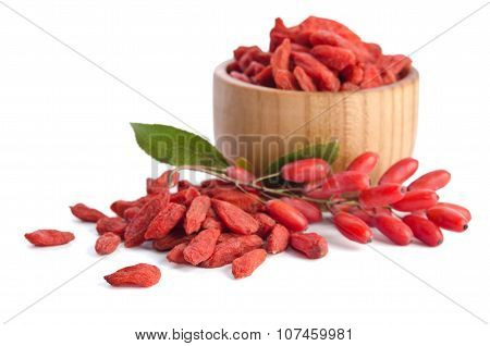 Barberries Near Goji Berries Heap Isolated On White Background