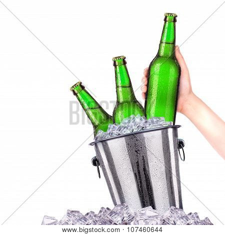 Set of beer's bottles with frosty drops in ice isolated on white background poster