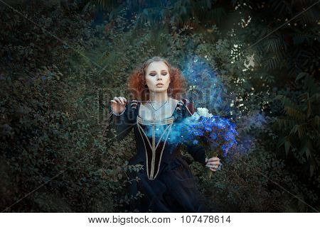 Girl with a magic wand. Red-haired girl in the forest enchants a bouquet of flowers. poster