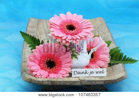 Dank je wel (thank you in Dutch) with pink  gerbera daisies