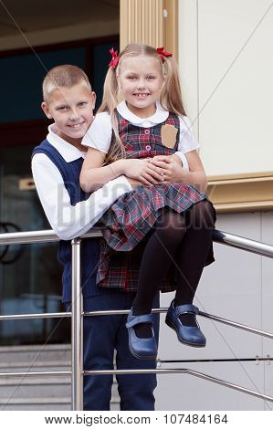 Portrait of cheerful and happy brother and sister schoolboy and schoolgirl outdoor