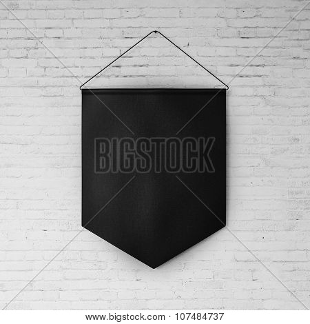 Black pennant hanging on the white bricks wall at background. 3d render