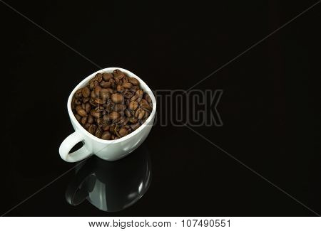 White Cup With Coffee Grains On Isolated Black