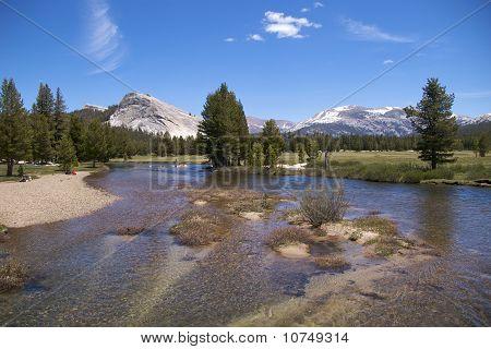 Hikers on Tuolumne River bank, Yosemite