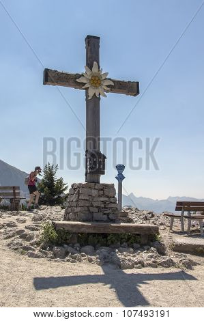 BERCHTESGADEN, GERMANY - AUGUST 13, 2015: Summit cross with the Edelweiss flower on top of the Kehlstein Obersalzberg close to Berchtesgaden in Bavaria