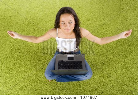 Woman With Laptop Relaxing On The Green Carpet