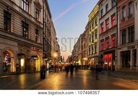 People Walk By Florianska Street In Krakow