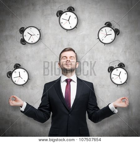 Meditative Businessman Is Pondering About Time Management. The Person In Formal Suit Is Surrounded B