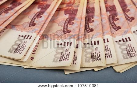 Russian Rubles Are Laid Out On A Gray Background