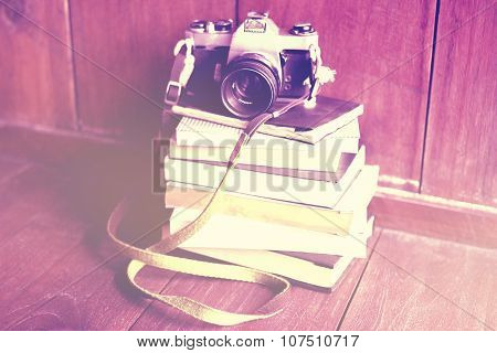 A Pile Of Book And Old Style Photo Camera On Wooden Floor, Instagram Photo Effect