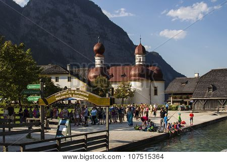 KOENIGSSEE, GERMANY - AUGUST 13, 2015: Entrance to St. Bartholomae on the Koenigssee near Berchtesgaden in Bavaria with the Church of St. Bartholomew in the background