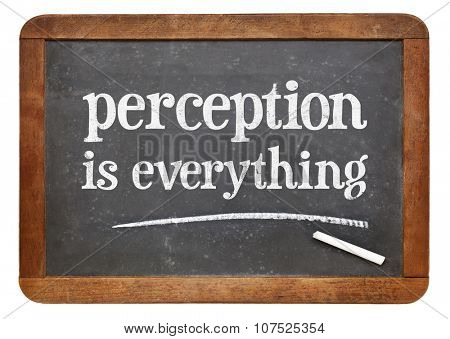Perception is everything - white chalk text on a vintage slate blackboard