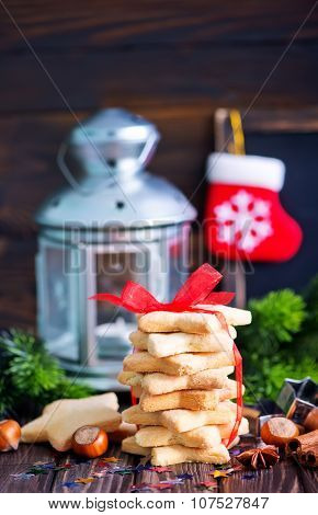 christmas cookies and christmas decoration on a table poster