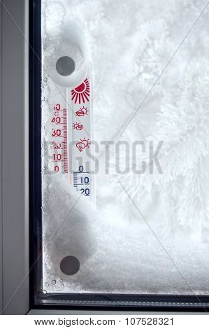 Outer Thermometer On A Frozen Window