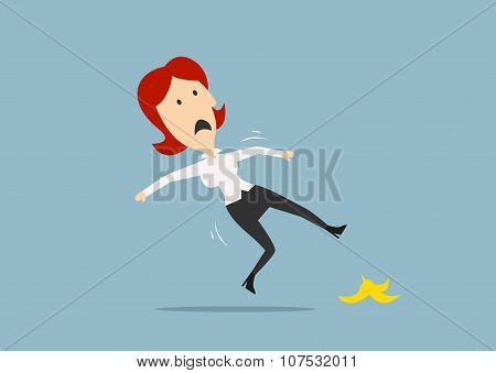 Businesswoman slipping on a banana peel