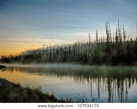 Mystic river with fog reflected