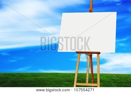 Easel With Blank Art Canvas In Grassland