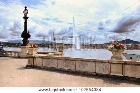 Geneva, Switzerland - July 12, 2014.  Jet D'eau On Lake Geneva, Switzerland With Flowers In The Fore