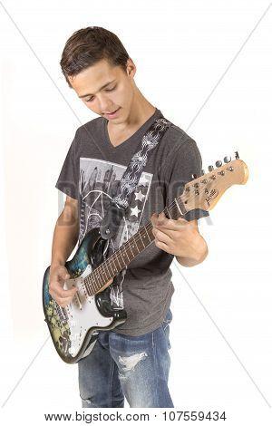 Teenage Boy Playing An Electric Guitar