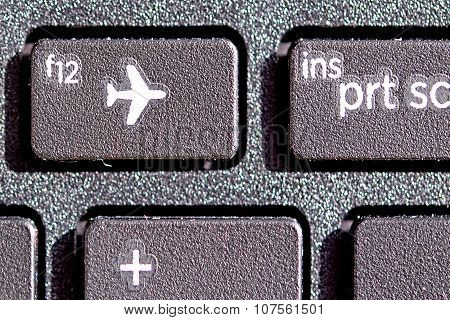 with plane sign on keyboard