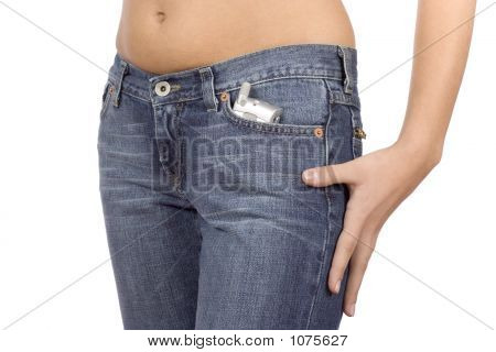 Woman'S Hip Wearing Jeans With Mobile Phone In The Pocket