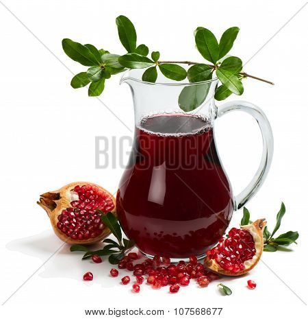 Jug of freshly squeezed pomegranate juice and twig and fruits of pomegranate tree isolated on white background poster