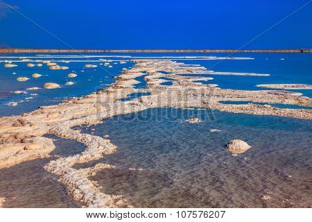Dead Sea off the coast of Israel. Vaporized salt form whimsical patterns on the surface water poster