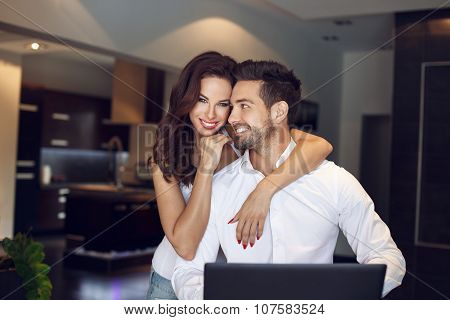 Happy Young Successful Manager Couple At Home