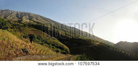 Sun Rays Over Mountain