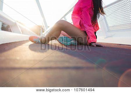 Fit women dressed in sportwear relaxing after workout outside
