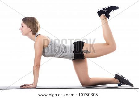 Sporty Woman Doing Butt Exercise
