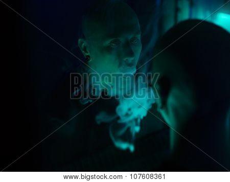 Club Party - Nightlife. Handsome Sexy Young Stylish Man Smoking In Nightclub