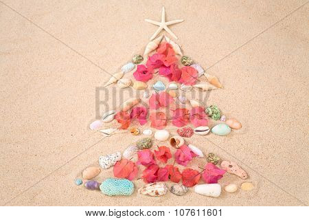 Beach Xmas Concept, Christmas Tree  On Sand Made Out Of Sea Shelles And Flower Pettal
