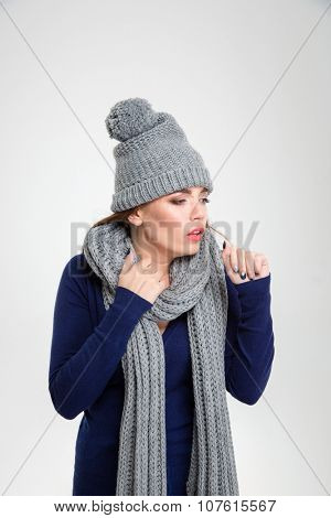 Portrait of a young ill woman coughs isolated on a white background