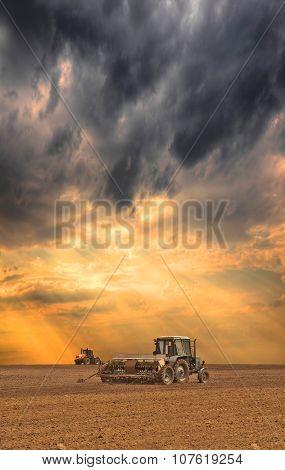 Tractors Seeding The Field