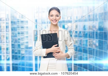 Portrait of businesswoman handing black papers, blue background. Concept of leadership and success